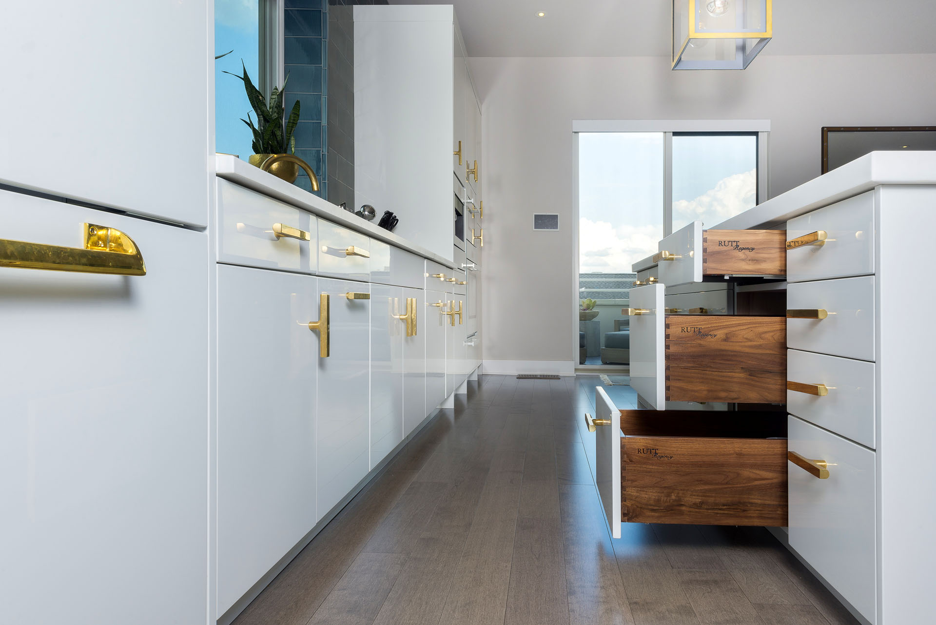Penthouse Condo With Gloss-white Finish & Walnut Drawers